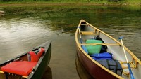 Canoes in water