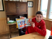 High school student Oscar Telschow with picture book for story time