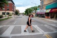 Amy Moreland walking across the street