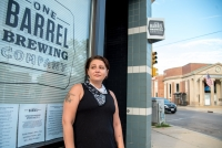 Amy Moreland stands outside a bar