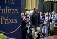 Pulitzer Prize winner for music Kendrick Lamar walks onto the stage to accept his award