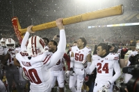 Wisconsin Badgers hold up Paul Bunyan's Axe
