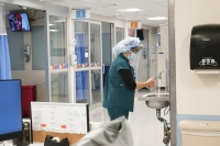 A medical staffer washes her hands in a New York hospital's section for COVID-19 patients