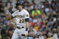 Milwaukee Brewers' Christian Yelich walks back to the dugout