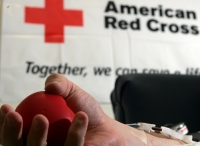 A blood donor squeezes a stress ball