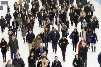 Commuters pass through the World Trade Center, Wednesday, Dec. 4, 2019 in New York