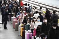 Workers return to factories in China
