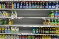 Empty shelves of cleaning supplies