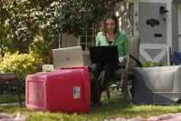 Alison Steffensen works at the home office she set up in the front yard of her home in Sacramento, Calif.