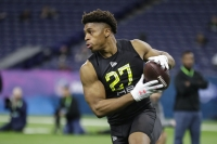 Wisconsin running back Jonathan Taylor runs a drill at the NFL football scouting combine