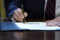 President Donald Trump signs the coronavirus stimulus relief package