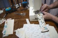Tailor Derek Nye Lockwood sews face masks