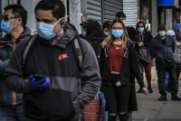 People in Brooklyn's Sunset Park wear masks to help stop the spread of coronavirus