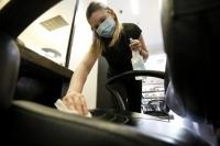 Michaela Kouvelas sanitizes a styling station at the Willo Aveda Salon
