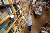 Jordan Vroon, left, takes inventory in Parnassus Books in Nashville, Tenn.