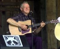 Doc Watson performing
