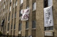 """Signs reading """"No Job No Rent"""""""