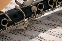 A clarinet resting on sheet music