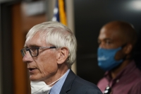 Tony Evers speaks during a news conference