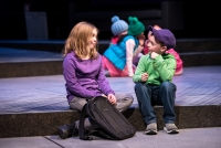 two children on a theater stage talking