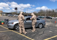 Wisconsin National Guard members test Arthur Soto for COVID-19