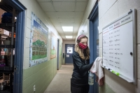 Raina Villarreal, who works as intake staff at the Humane Society of Southern Wisconsin, does routine cleaning