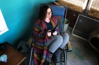 Mariah Clark sits on her porch