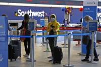 Travelers take coronavirus precautions at airport