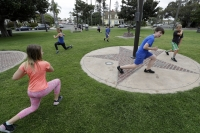 Kids exercise with their parents amid COVID-19 pandemic