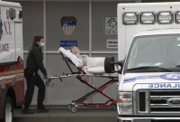 A patient is moved to an EMT in New York City during coronavirus pandemic