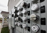 Watt-hour meters track electricity used by residents of an apartment building.