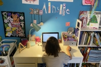 A student works at home desk