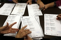 People recounting ballots