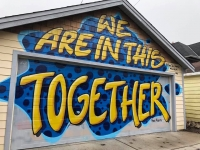 A homemade sign of encouragement on a garage in a Milwaukee neighborhood.