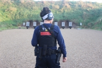 Recruit Clare Gloede listens to instructions at the Dane County Law Enforcement Training Center shooting range.