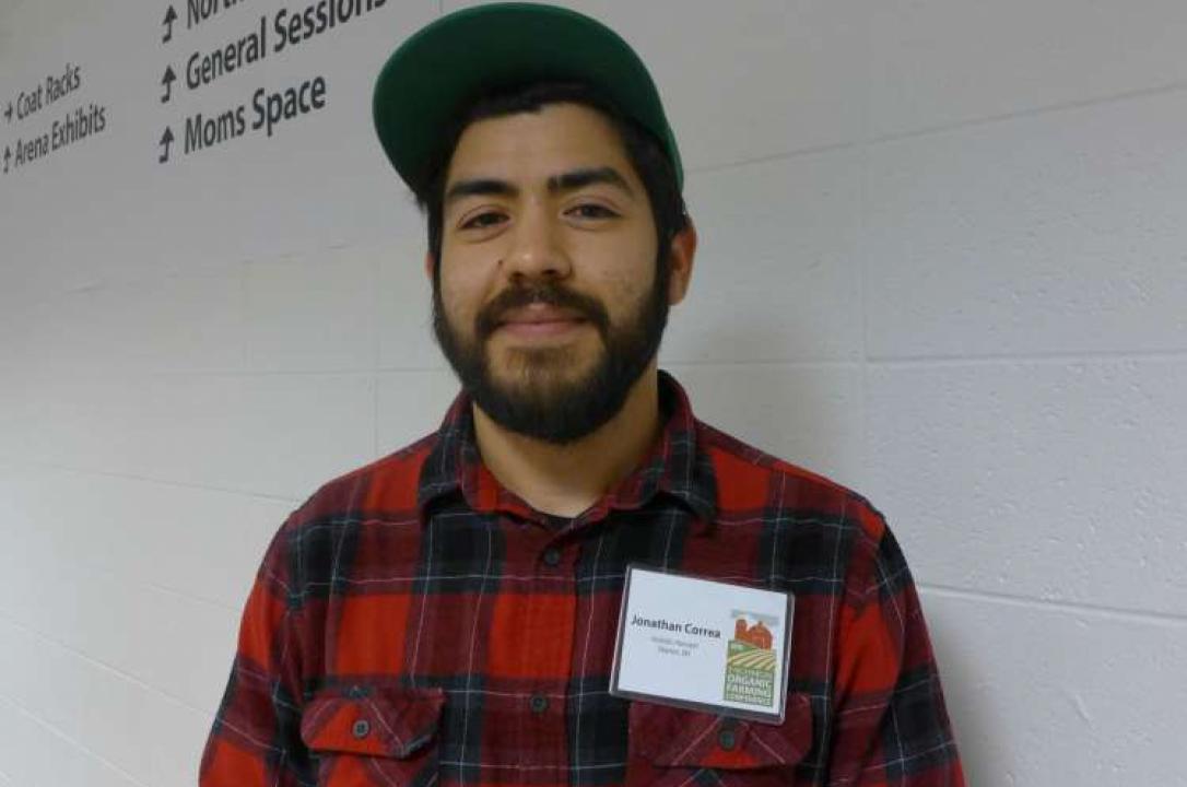 Photo of a bearded, plaid-shirted Jonathan Correa