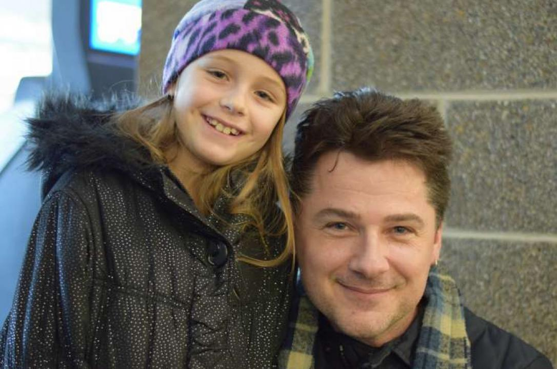 Kirk Stone and his 9-year-old daughter pose together during their interview