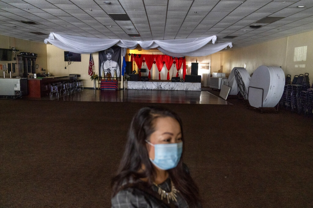 Businesswoman and city council member Maiyoua Thao stands in the virus-shuttered banquet hall in Appleton