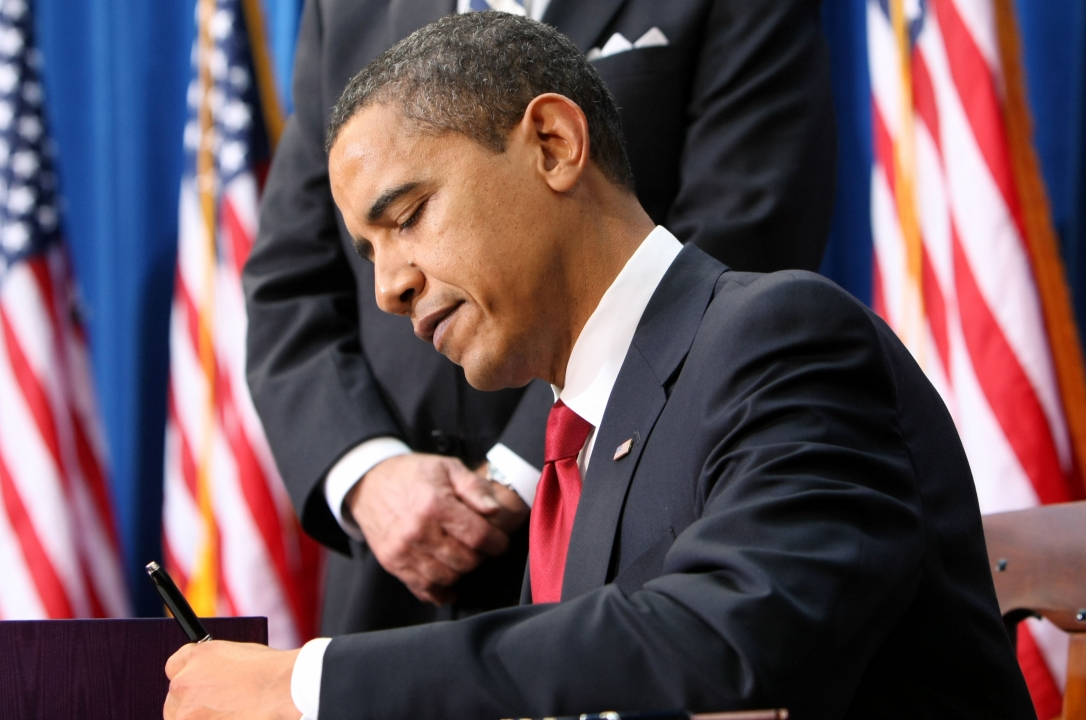 President Barack Obama signs the American Recovery and Reinvestment Act