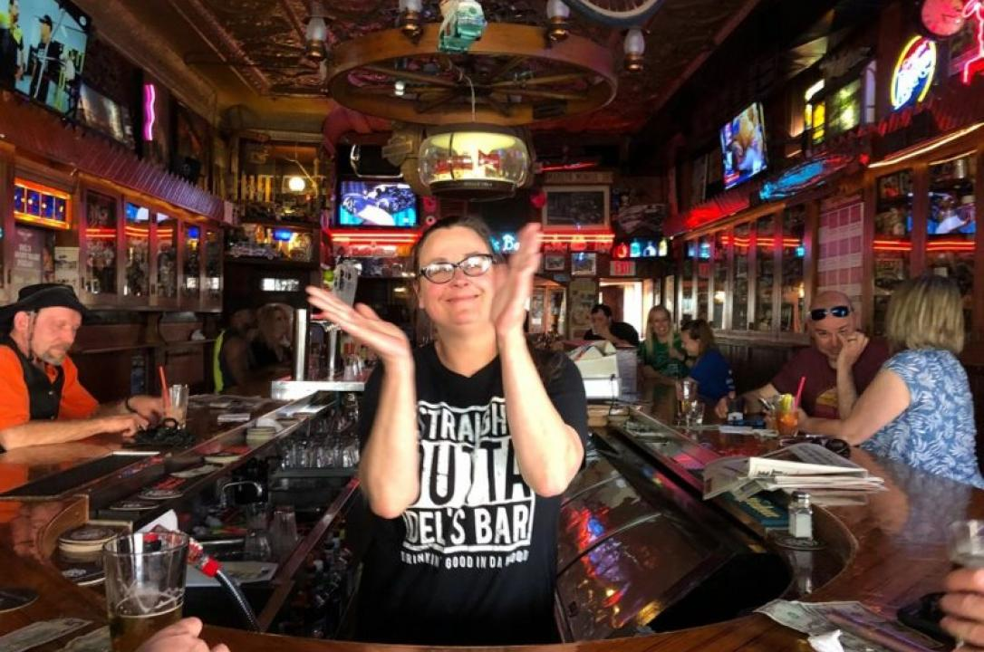 Sara Viner dances to the jukebox while working at Del's Bar