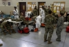 National Guard Soldiers practice putting on protective gear