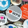 buttons and pins that say WPR scattered across a table