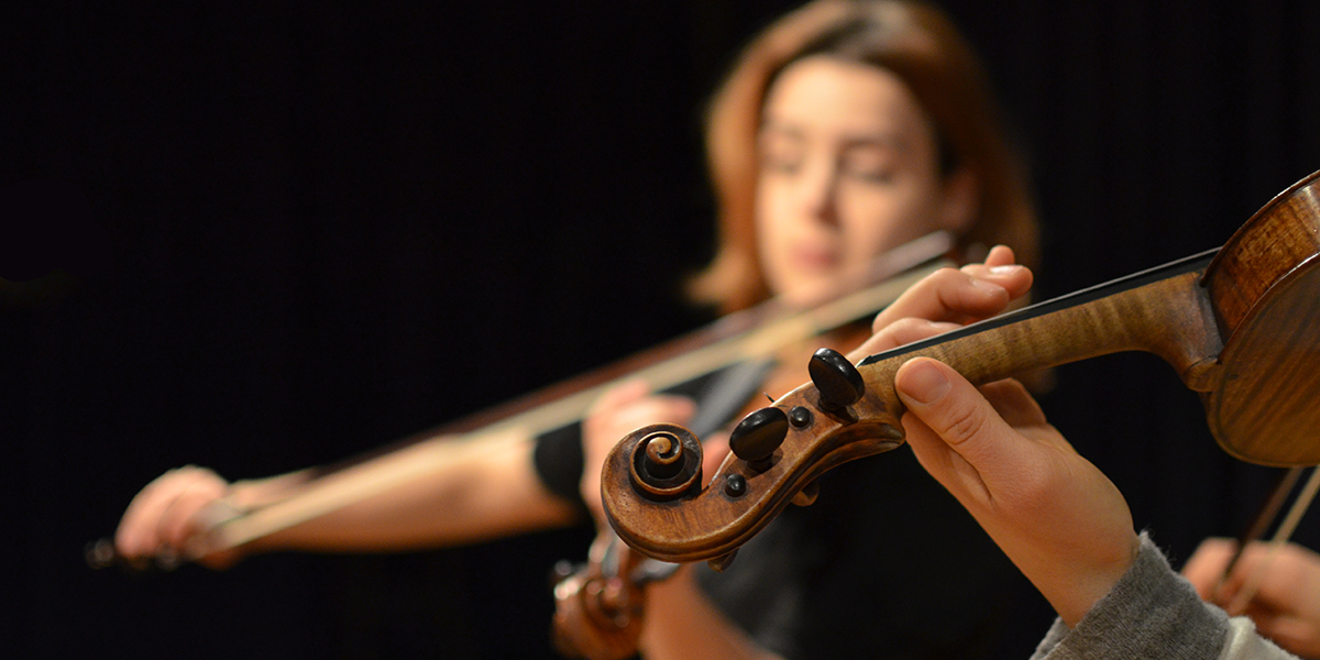Image of a woman playing a viola